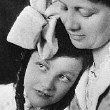 Age 9, with her mother. Circa 1914.
