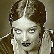 1928. A shot from 'Tide of Empire'; Joan as 'Josephine Guerrero' was replaced by Renee Adoree and the film released in 1929.