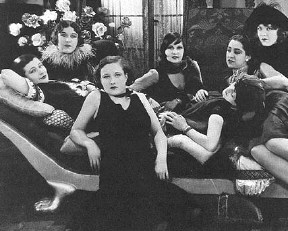 "Joan, front, with Parisian ""grisettes."""