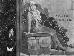 Harry Langdon admires Joan on a billboard in 'Tramp, Tramp, Tramp.'