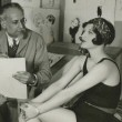 1927. Being sketched by vaudevillian and cartoonist Bert Levy.