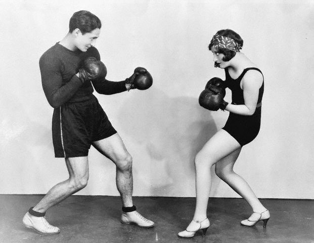 1927. Working out with trainer (later actor) Gene Alsace.