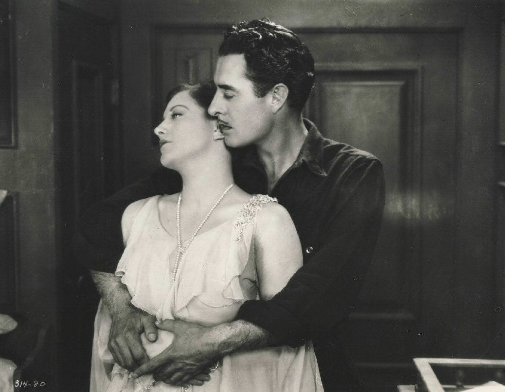 1927. A film still from 'Twelve Miles Out' with John Gilbert.