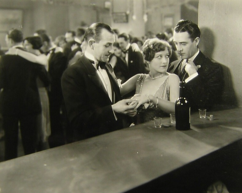 1928. 'Four Walls.' With Louis Natheaux and John Gilbert, right.