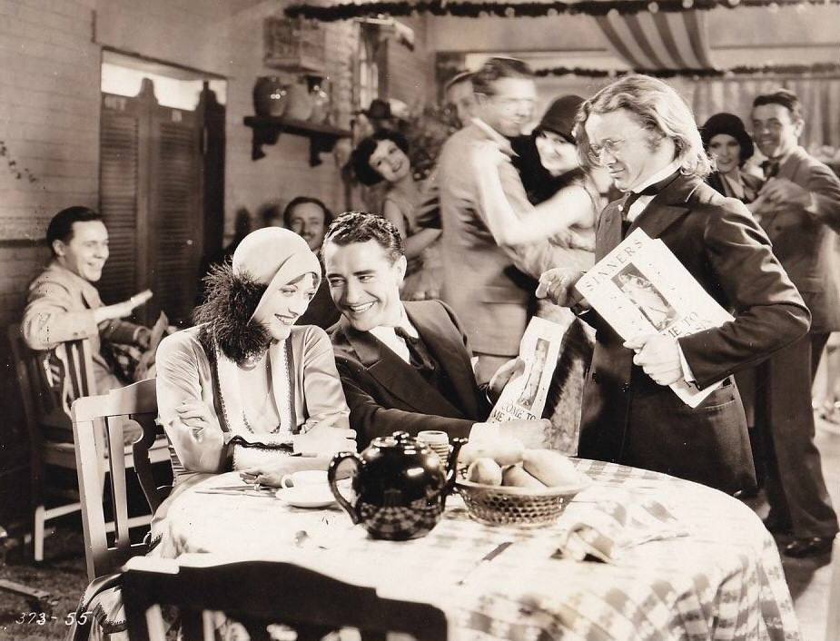 1928. 'Four Walls.' With John Gilbert, left.