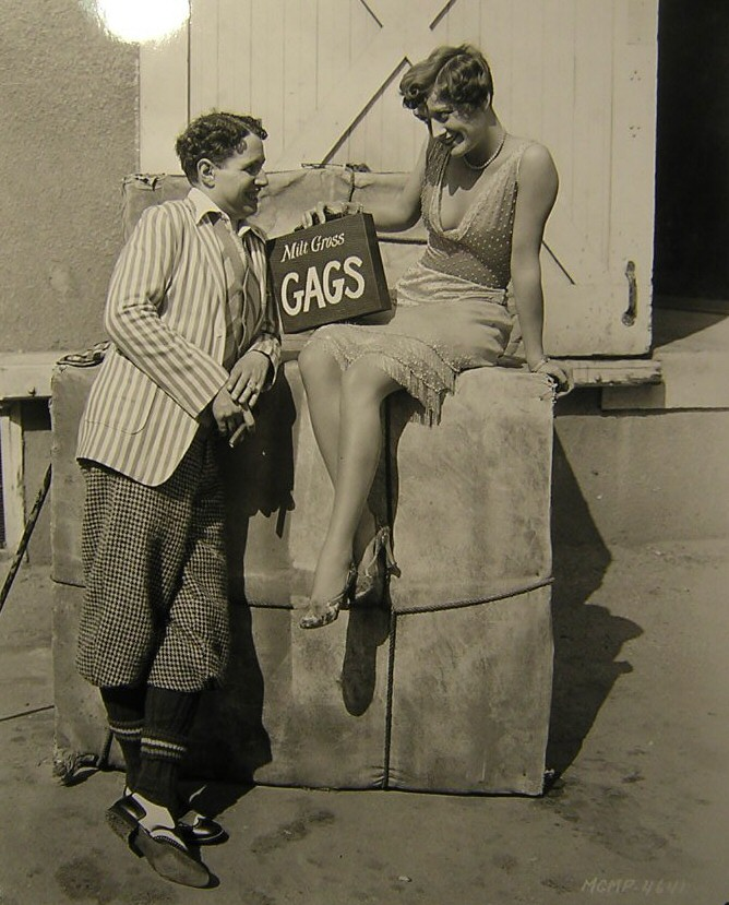 1928. On the set of 'Four Walls' with comic-strip artist Milt Gross.