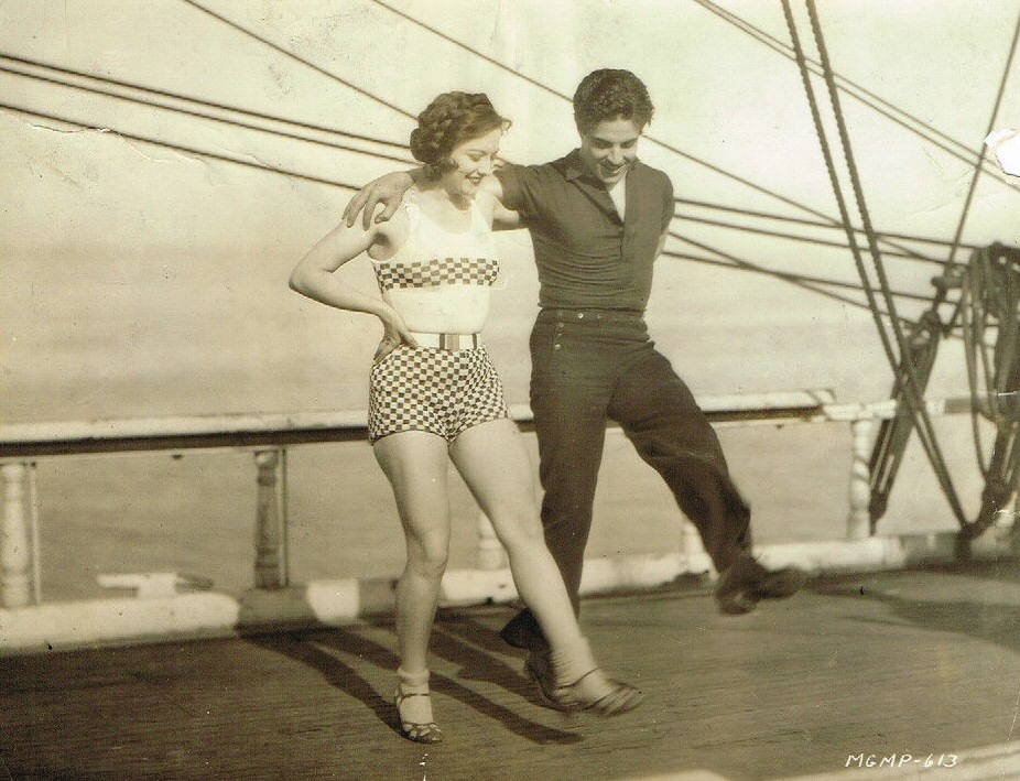 1928. On the set of 'Across to Singapore,' with Ramon Novarro.
