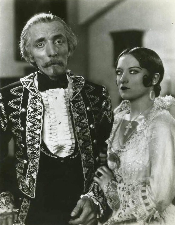 1928. With unknown in scene from 'Tide of Empire.'