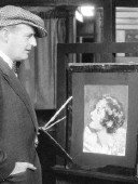 1930. Unknown artist with Joan and painting.