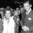 Joan, with Doug, putting her hand- and footprints outside Grauman's Theater. 9/14/29.