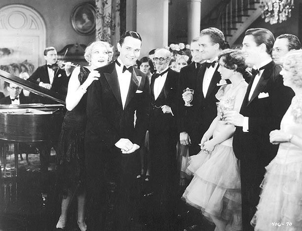 Joan with Gwen Lee and William Haines (latter two to far left).