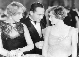 In '29's 'Duke Steps Out.' (From left: Lee, William Haines, Joan.)