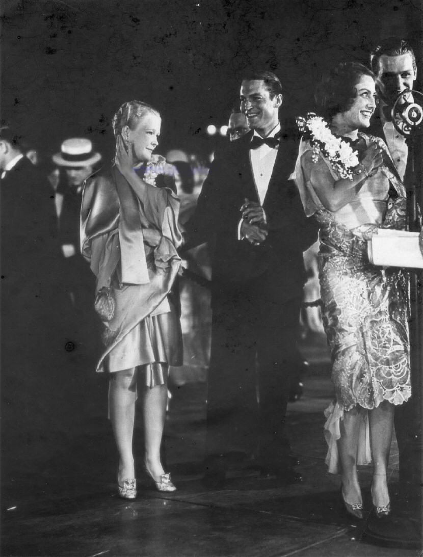 August 1929. The premiere of 'Hollywood Revue of 1929' at Grauman's. Joan and Doug at right. Chester Morris and wife Suzanne Kilbourne at center.