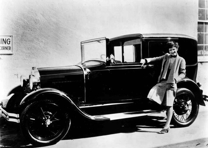 1929. Taking a break from 'Our Modern Maidens' to show off her new Model A Ford.