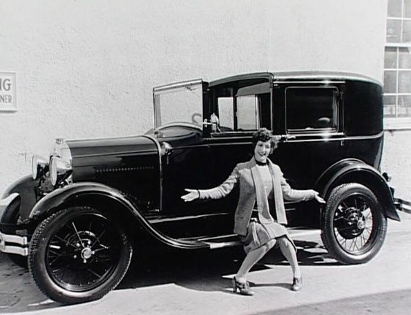 1929. On the set of 'Our Modern Maidens' with her new Model A Ford.