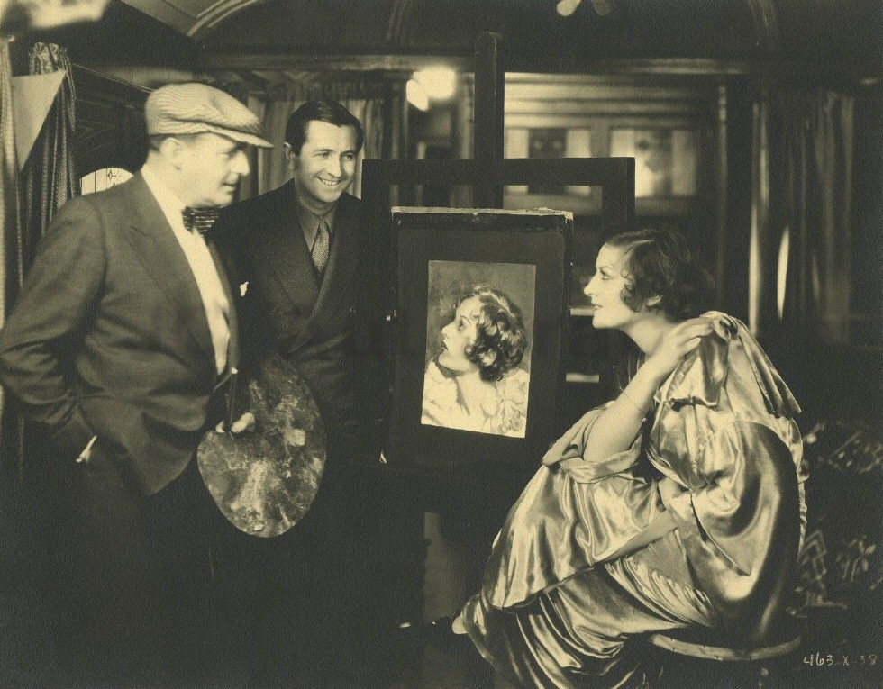 1930. On the set of 'Montana Moon' with artist Henry Clive.