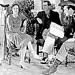 Joan with sprained ankle on the set of 'Montana Moon.' With director Malcolm St. Clair and Johnny Mack Brown.