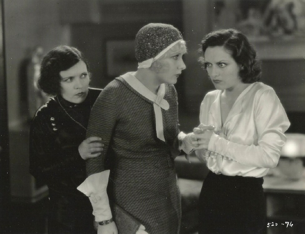 1930. 'Paid.' Marie Prevost at left.