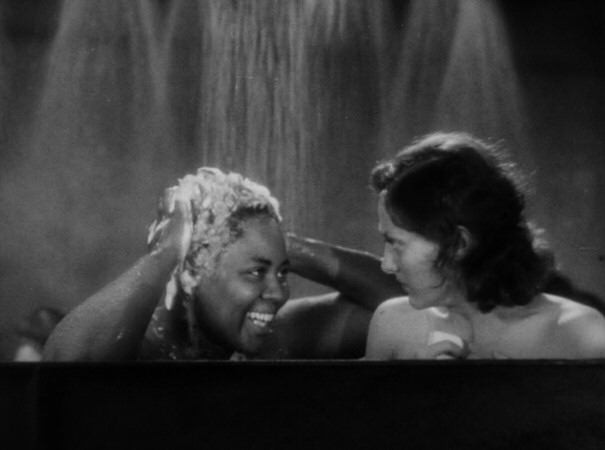 1930. 'Paid.' With Louise Beavers. 'Don't worry, honey, it all goes down the drain.'