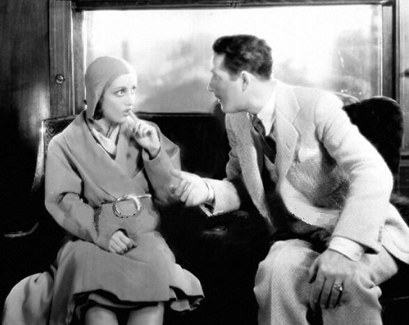 1930. A film still from 'Great Day!' with John Miljan.