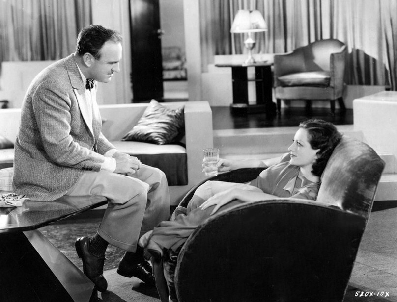 1930. On the set of 'Paid' with director Sam Wood.