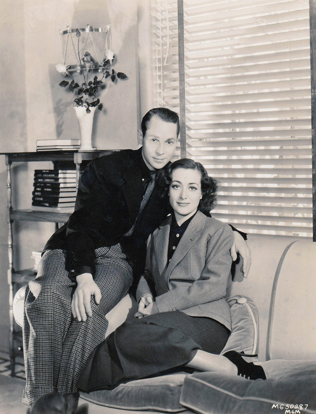 1936. Joan and Franchot at home.