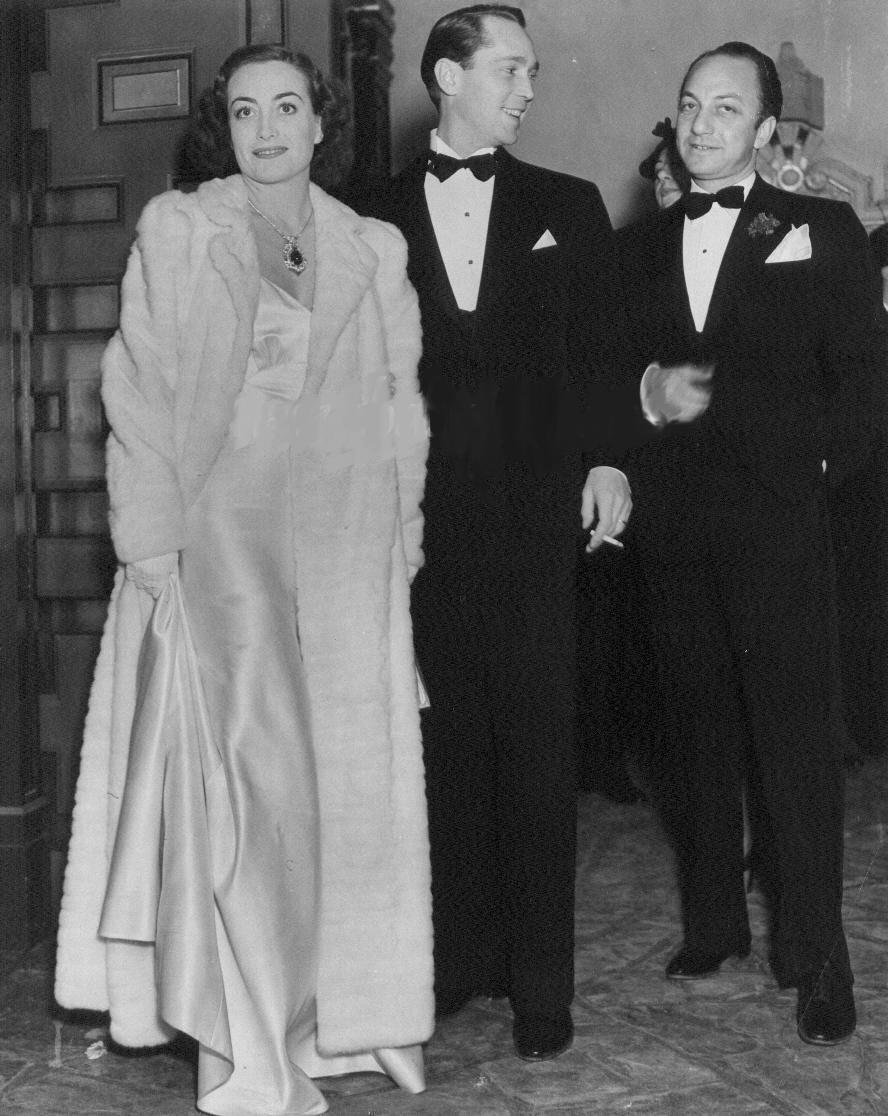 1936. With husband Franchot Tone and Jerry Asher.
