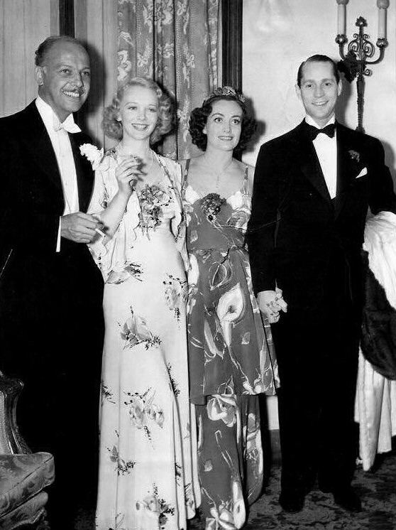 April 19, 1936, at the Beverly Wilshire Mayfair Ball with Mitchell Leisen, Virginia Bruce, and Franchot Tone.