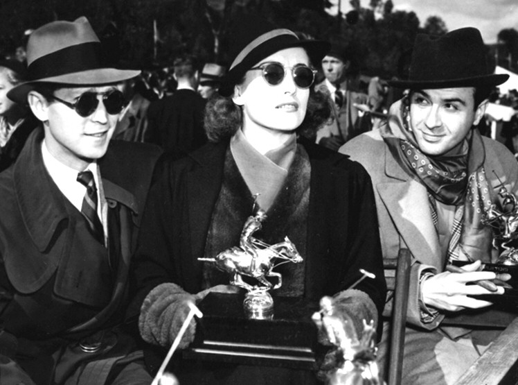 November 1936. At a polo match with husband Franchot Tone.