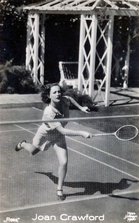 1936 playing badminton at home. Shot by Bud Graybill.