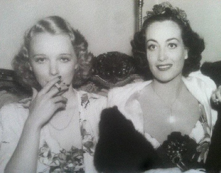 April 19, 1936, at the Beverly Wilshire Mayfair Ball with Virginia Bruce.