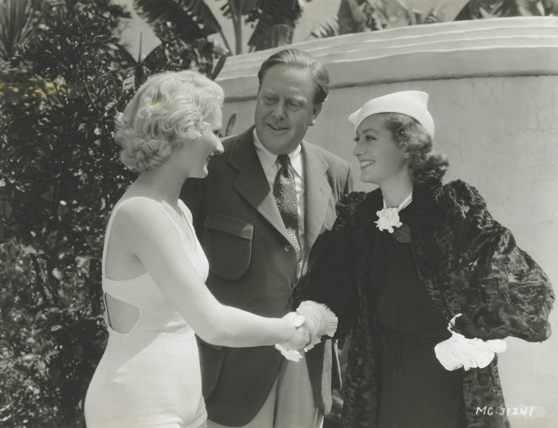 1933. With director Robert Z. Leonard and Anita Thomas of Dallas, who won a bit part in 'Dancing Lady.'