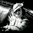 1932. In her Cadillac Fleetwood.
