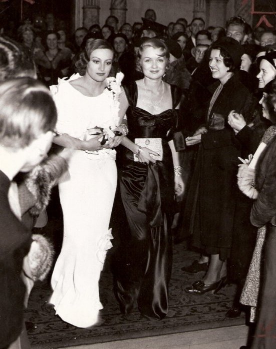 1932. With Constance Bennett, at LA's Biltmore Hotel.