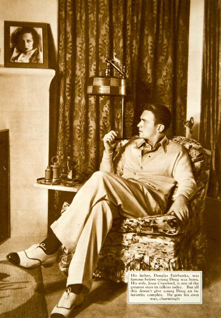 Husband Douglas Fairbanks, Jr., at home in 1931.