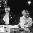 With husband Doug Fairbanks, Jr., at the 'Grand Hotel' premiere.
