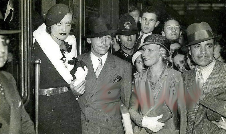 July 1932 at Victoria Station with husband Doug and British actress Heather Thatcher.