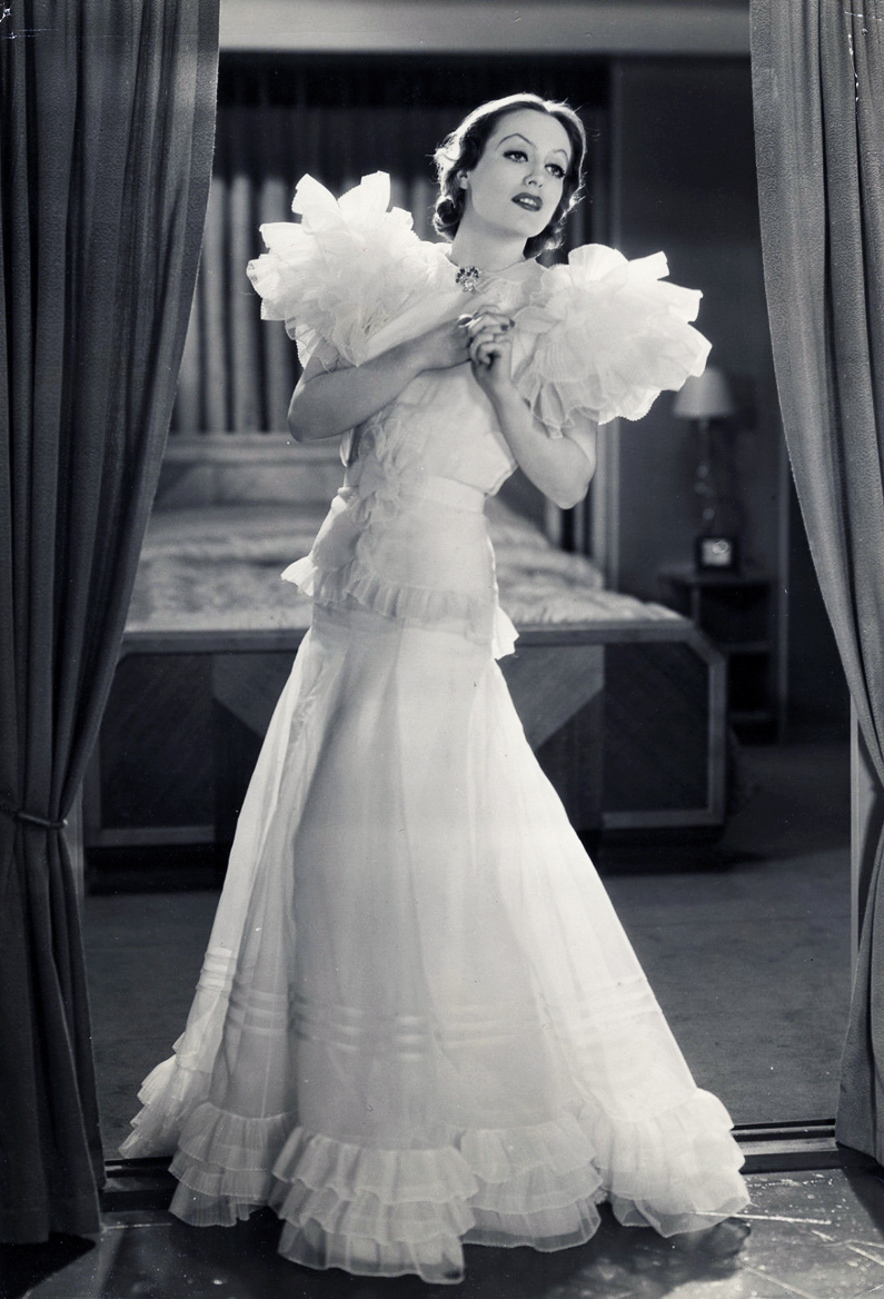 1932. 'Letty Lynton' publicity, with dress by Adrian.