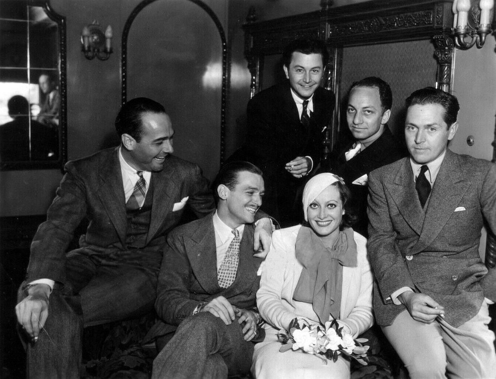 1932. Arriving back in California on the 'Chief' train. With William Haines, husband Doug, Robert Young, Jerry Asher, and Alexander Kirkland.