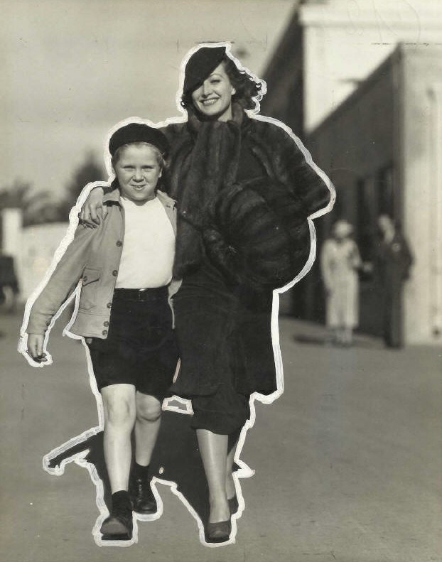 Circa 1933. With Jackie Cooper on the MGM lot. (White marks by a photo editor of the time.)