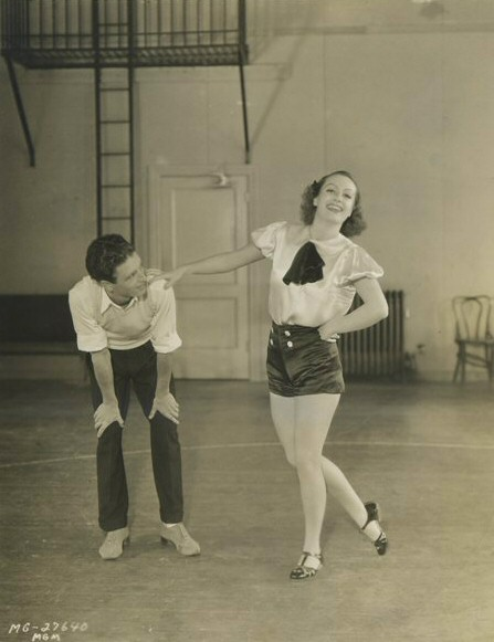 1933. With her dance instructor on the set of 'Dancing Lady.'