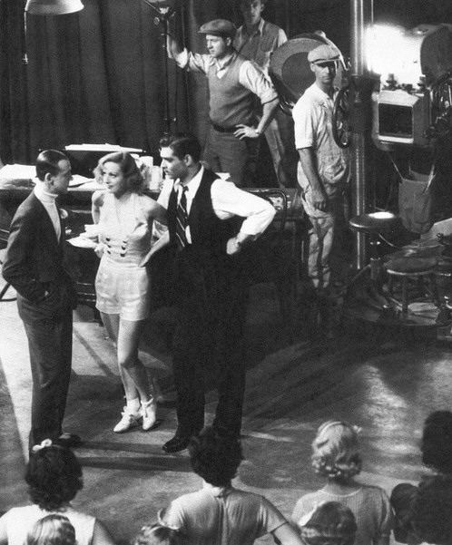 1933. On the set of 'Dancing Lady' with Fred Astaire and Clark Gable.