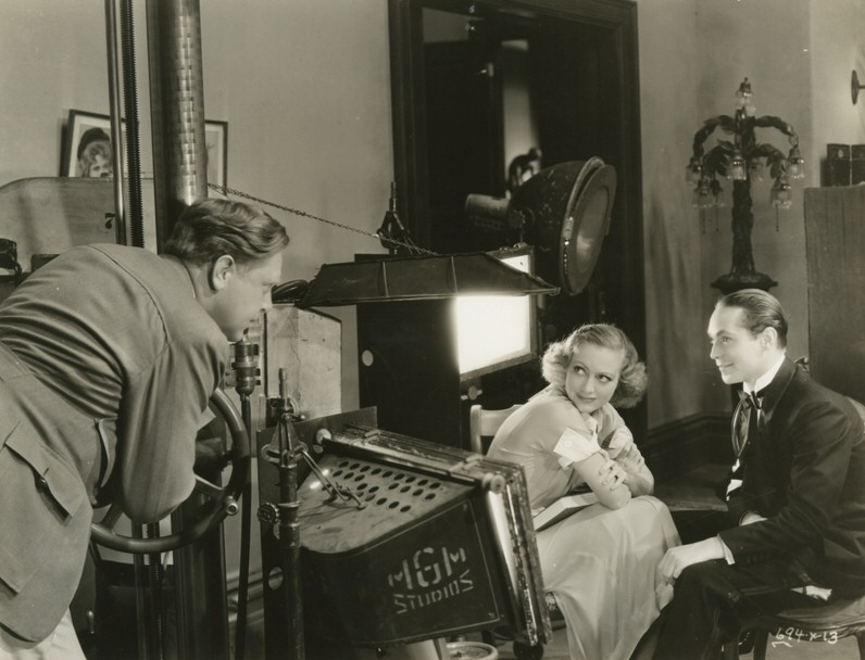 1933. On the set of 'Dancing Lady' with director Robert Z. Leonard and Franchot Tone.