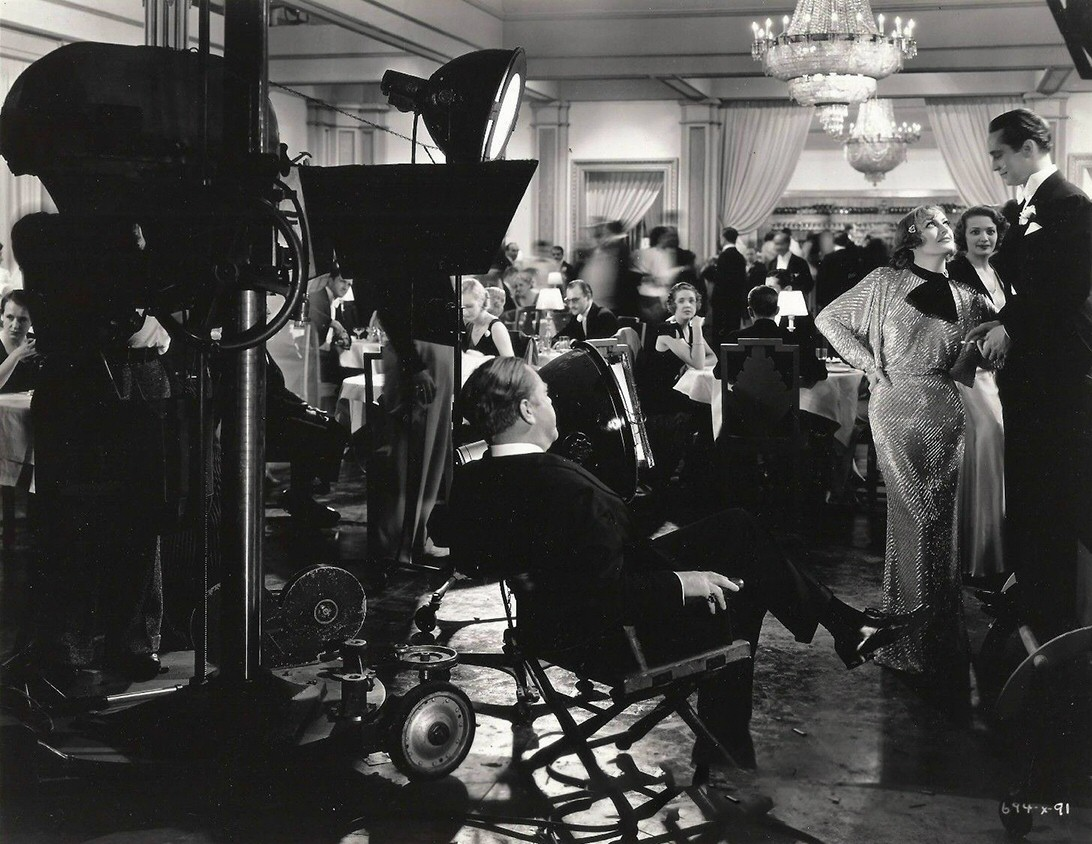 1933. Filming 'Dancing Lady' with director Leonard and Franchot Tone.
