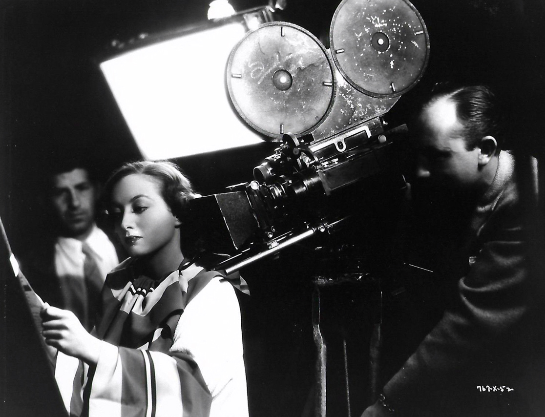 1934. 'Chained.' On the set with director Clarence Brown.