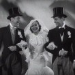 Screen shot with Robert Montgomery and Clark Gable.