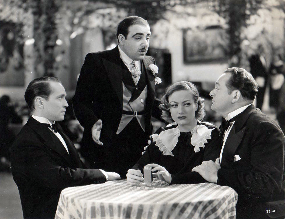 1934. 'Sadie McKee.' With Franchot Tone, left, and Edward Arnold, right.