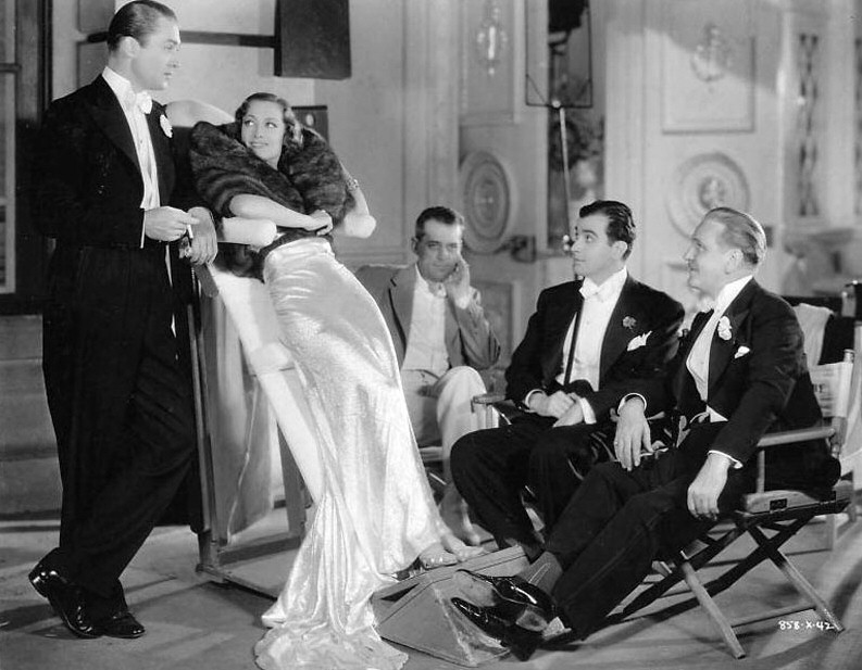 1935. On the set of 'I Live My Life' with Brian Aherne, et al.