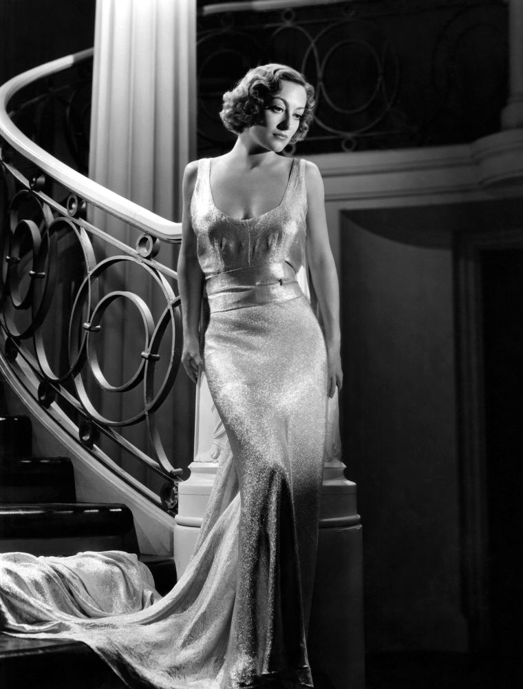 1935. 'I Live My Life' publicity with dress by Adrian.