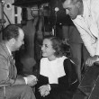 1935. On the set of 'I Live My Life.' With producer Bernard Hyman and director W. S. Van Dyke.